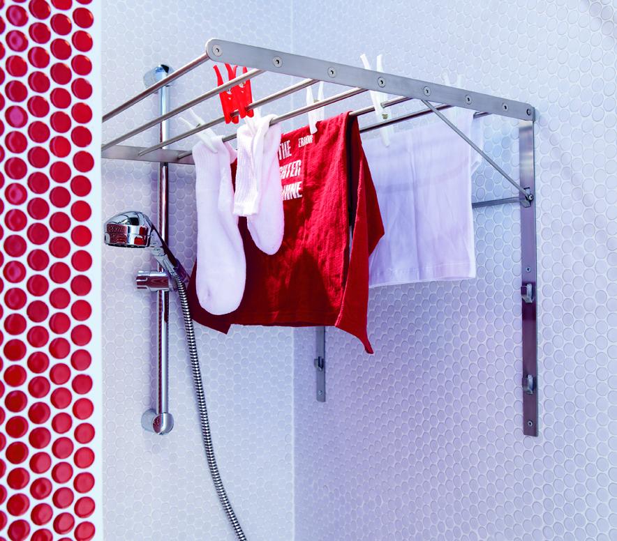 Une salle de bains avec un coin buanderie - Sechoir salle de bain mural ...