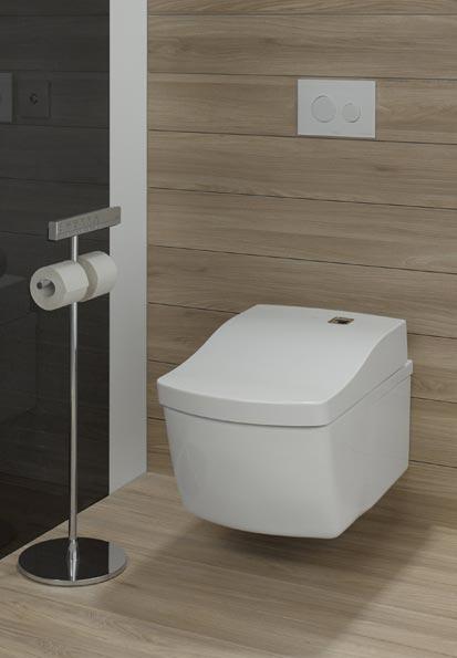 WC lavants haut de gamme : Le modèle Toto, dans des toilettes revêtues de bois
