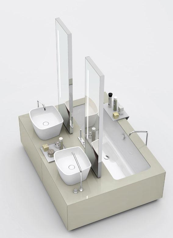 photo d'un îlot de salle de bains, avec deux vasques et une baignoire