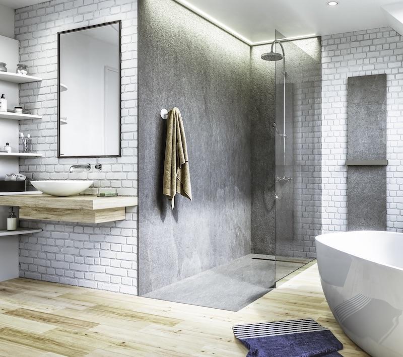 salle de bains avec douche revêtue de feuilles de pierre