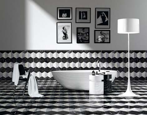 Une salle de bain avec un sol et un soubassement carrelés de noir et blanc