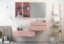 Salle de bain rose : meuble rose sur fond de mur blanc cassé