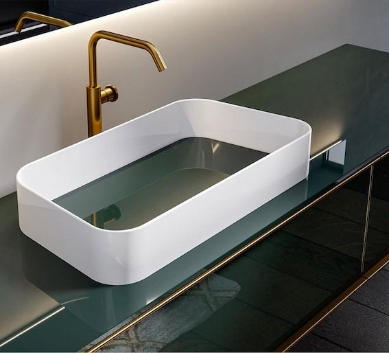 vasque à poser blanche en matériau composite avec cache bonde vert