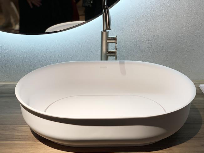 vasque à poser en solid surface avec clapet de bonde invisible