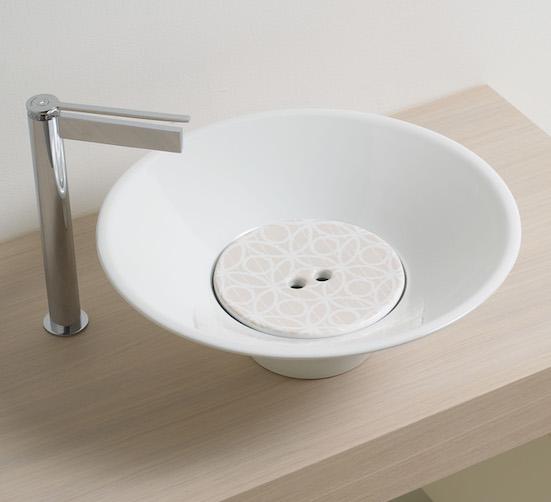 vasque à poser avec cache-bonde décoré