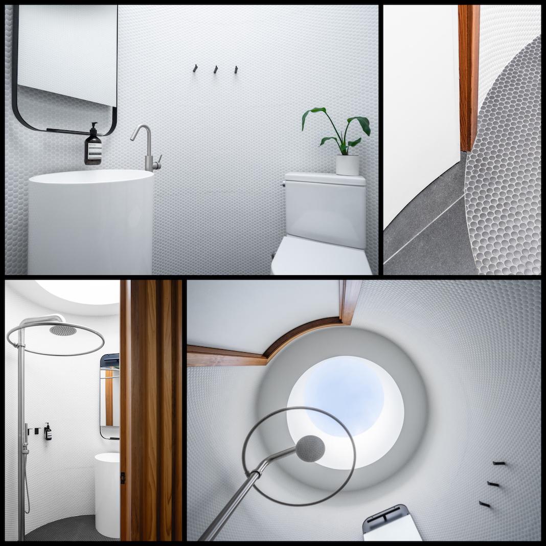 Une salle d'eau blanche dans un espace cylidrique
