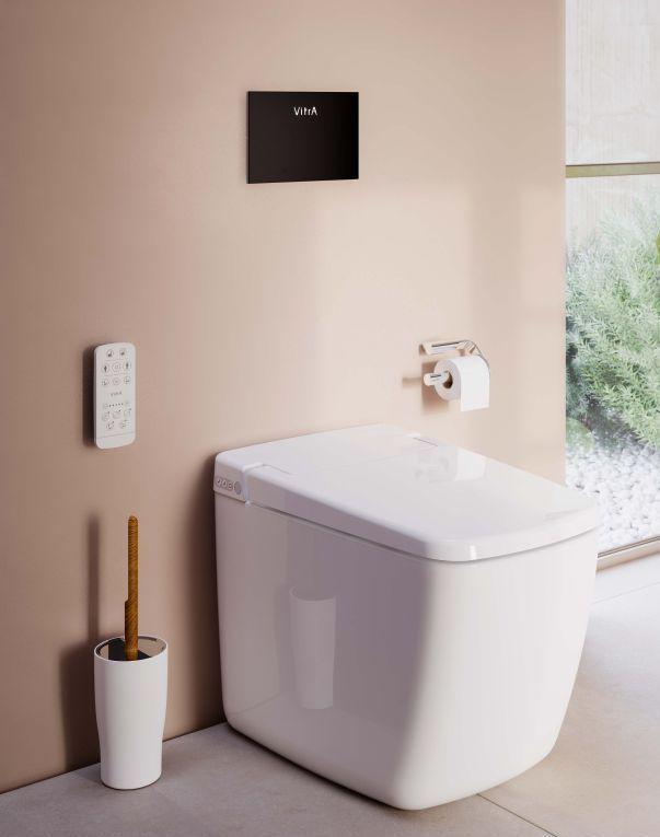 WC lavant sur pied blanc sur mur rose
