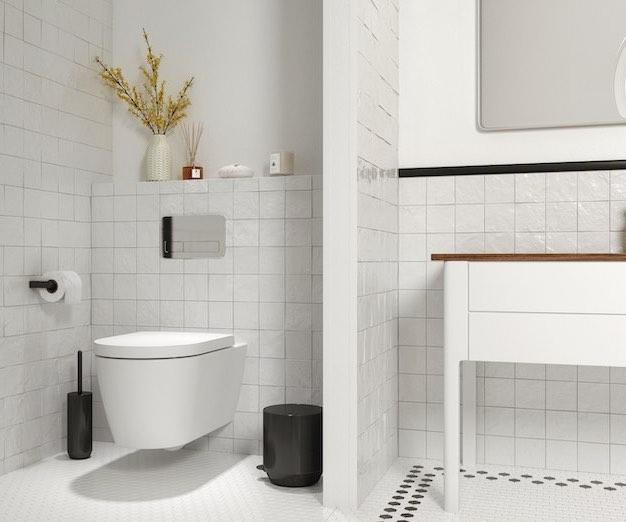 un WC suspendu séparé du meuble vasque par une cloison