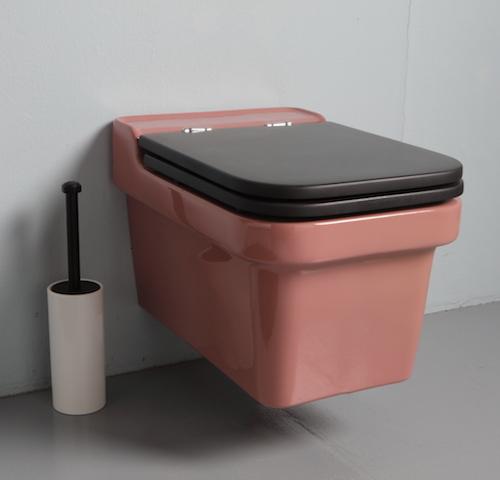 WC suspendu rose avec abattant bois
